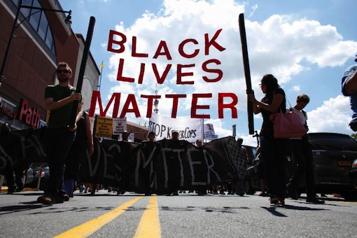 Demonstrators march during a Michael Brown memorial protest in Brooklyn, New York on August 9, 2015 (AFP Photo/Kena Betancur)
