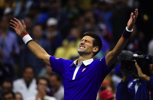 Novak Djokovic celebrates after defeating Roger Federer at the US Open final at Arthur Ashe Stadium in New York on September 13, 2015 (AFP Photo/Jewel Samad)