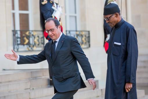 President Francois Hollande of France ushers President Buhari of Nigeria