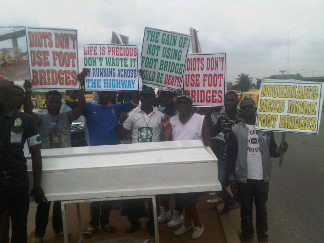Group campaigns with mock coffin to promote use of pedestrian bridges