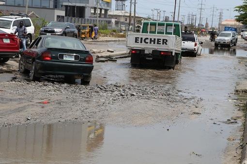 Poor state of Lekki Phase one road leading to the Estate.   Photo: Idowu Ogunleye