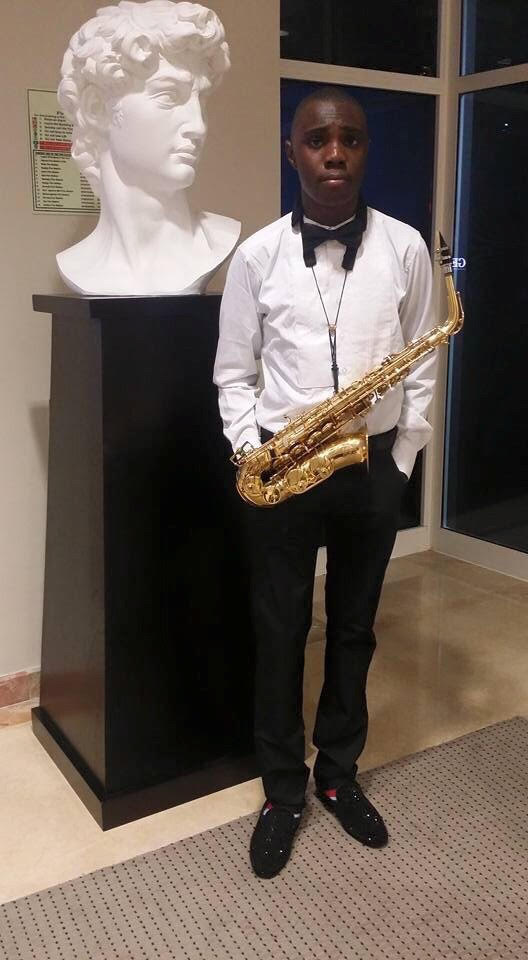 Teen saxophonist TJ Emore