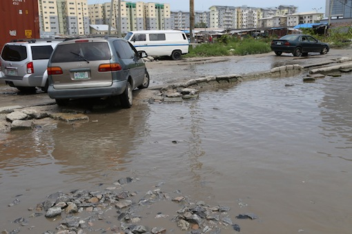 The Lekki residents finding it difficult to navigate the pathetic road.  Photo: Idowu Ogunleye