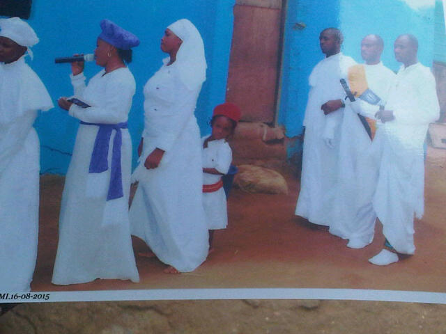 Tope inside church with her parents and elders of the church before she was stolen