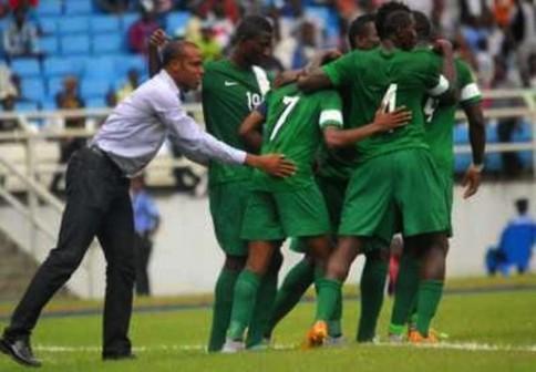 FILE PHOTO: Super Eagles players celebrate with coach Sunday Oliseh