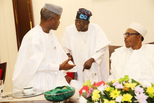 FILE PHOTO: President Muhammadu Buhari looks on as Bola Tinubu and Vice President, Yemi Osinbajo chat during the Presidential Dinner in honor of Senators at the State House in Abuja
