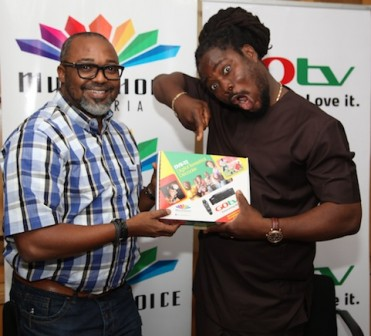 L-R: John Ugbe, Managing Director, MultiChoice Nigeria signing the contract paper with Daddy Showkey as GOtv Ambassador