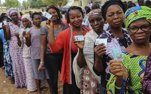FILE PHOTO: Kogi voters show their PVCs