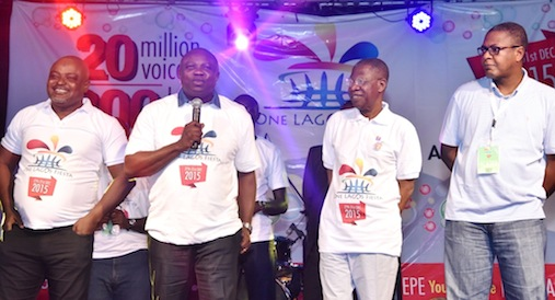 Lagos State Governor, Mr. Akinwunmi Ambode(2nd left), addressing fun lovers and Agege residents, during the flag off of the One Lagos Fiesta, at the Agege Mini Stadium, Agege, Lagos, on Sunday, December 27, 2015. (L-R) With him are Speaker, Lagos State House of Assembly, Rt. Hon. Mudashiru Obasa; Minister for Information & Culture, Alhaji Lai Mohammed and Commissioner for Tourism, Arts & Culture, Mr. Folorunsho Coker.