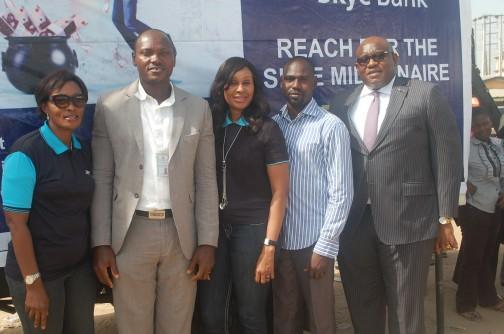 "L-R:  Area Manager, Greater Lagos 2, Skye Bank Plc., Adejumoke Odutola, Assistant Manager, National Lottery Regulatory Commission, Lagos 2, Horace Abolo, Head, Retail Banking, Skye Bank Plc., Nkolika Okoli,  Administration Manager , National Lottery Regulatory Commission, Lagos 2, Adebajo Adebola and  Regional Director, Ikeja, Skye Bank Plc., Ndubuisi Osakwe  at the  Bank's ""Reach For The Skye""  reward draw held in Better Life Main Market , Ikorodu  Lagos recently."