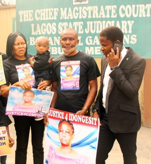 L-R: President Women Arise, Dr. Joe Okei-Odumakin with Elijah Udoh; widower Mr. Godwin Udoh & Barr. Christian Love  at the hearing on the alleged murder of Mrs Idongesit Udoh by Police officer, Museliu Aremu, at the Magistrates' Court, Ebute Metta on Wednesday, 27 Jan., 2016