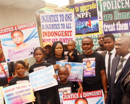 L-R: Children of the late Mrs Idongesit Udoh, Blessing, Mary , Abraham, President Women Arise, Dr. Joe Okei-Odumakin with Elijah Udoh; widower Mr. Godwin Udoh, Barrister Christian Love & Silas Udoh at the hearing on the alleged murder of Idongesit Udoh by Police officer, Museliu Aremu, at the Magistrates' Court, Ebute Metta on Wednesday, 27 Jan.; 2016