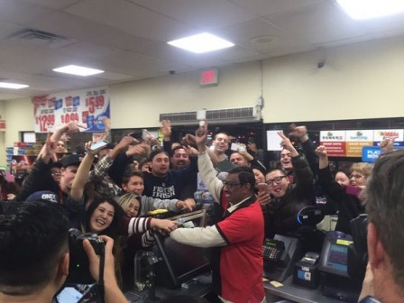 Crowds gather at the 7 Eleven store in Chino Hills where the winning Powerball ticket was sold Wednesday