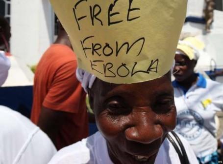 File Photo: A Sierra Leonian celebrates Ebola free status last November. Liberia also gets WHO all clear