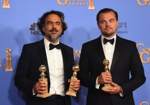'The Revenant' director Alejandro Gonzalez Inarritu (L) and leading actor Leonardo DiCaprio pose with their awards during the 73nd annual Golden Globe Awards, at the Beverly Hilton Hotel in Beverly Hills, California, on January 10, 2016 (AFP Photo/Frederic J Brown)