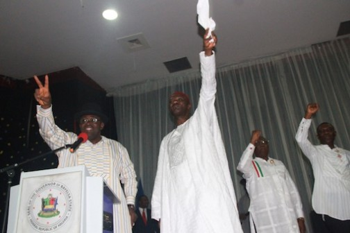 L–R: Bayelsa State Governor, Hon. Seriake Dickson, PDP National Vice President, South-South, Dr. Cairo Ojuogbo, Special Adviser to the Bayelsa State Governor on Political Matters, Mr. Fyneman Wilson, and the State SSG, Dr. Edmond Allison Oguru, acknowledging cheers from the audience, during a meeting of all political appointees in the State, at the Banquet hall, Government House, Yenagoa. Photo by Michael Owi.