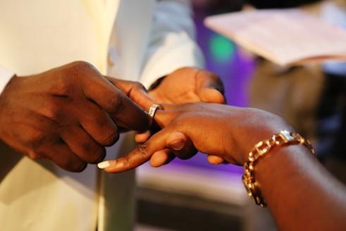 Adefemi slips the ring on Olubukola's finger