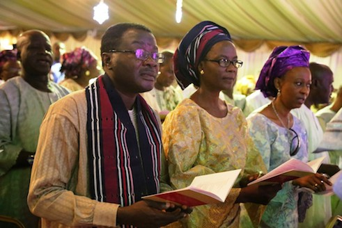 Executive Editor of TheNEWS, Kunle Ajibade and his wife with a guest