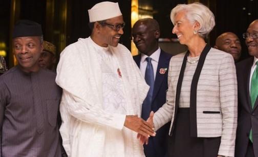 FILE PHOTO: Nigeria's vice president, Prof. Yemi Osinbajo looks on as President Muhammadu Buhari shakes IMF's Christine Lagarde