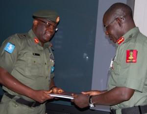 Major-General-Adeniyi-Oyebade-GOC-1-Division-submitting-report-to-Chief-of-Army-Staff-Lieutenant-General-Tukur-Yusuf-Buratai