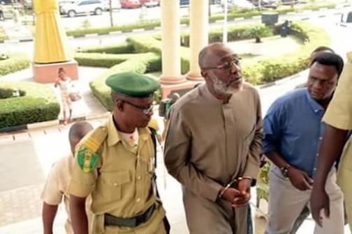Olisa Metuh arrives court in handcuffs