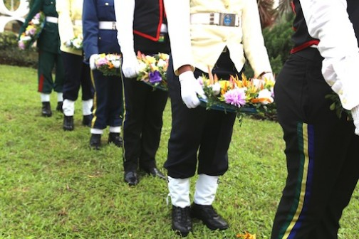 Millitary personnel with wreaths in honour of fallen heroes