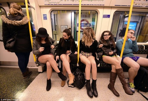 Four ladies bare all on the London underground on Sunday as a part of the international 'No Pants Subway Ride'