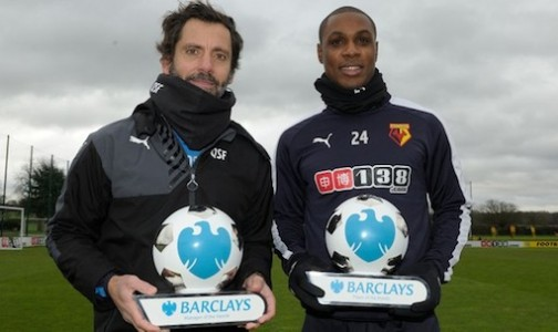 Quique Sanchez Flores and Odion Ighalo pose with their awards