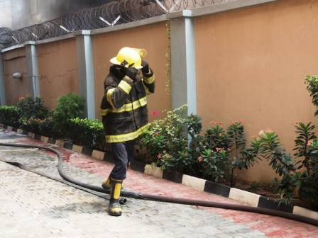 A fire service personnel trying to get their equipment close to the burning building Photo: PM News