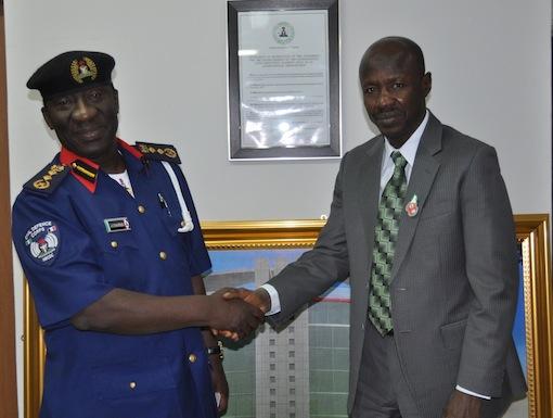 NSCDC chief Abdullahi Gana Muhammadu shake hands with his EFCC counterpart, Ibrahim Magu
