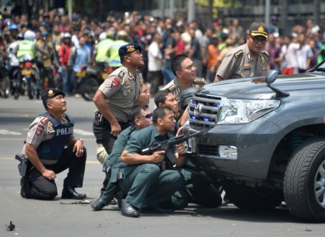 Indonesian police aiming at the attackers today. AFP