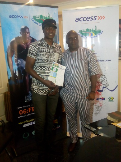 Sound Sultan (left) with Deji Tinubu, chairman of the   local organising committee of Access Bank Lagos City Marathon on Friday a