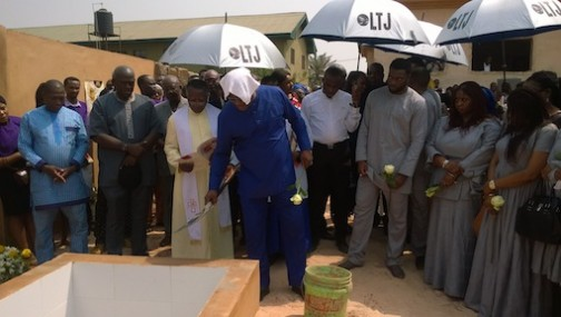 Stephen Keshi performing dust to dust during the burial of his late wife, Kate