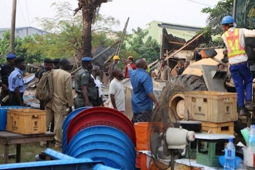 The GM,  Kabiru Yusuf Yar'Adua, personally directing the demolition exercise