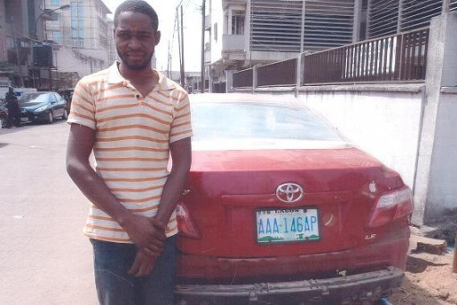 Suspected car thief, Mathias Isa with the Toyota Camry car he allegedly stole from Marina car park in Lagos and took to Kogi