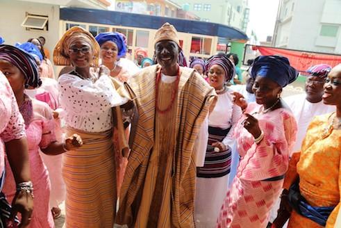 Father of the groom, Babatunde Onanuga dancing into the reception hall