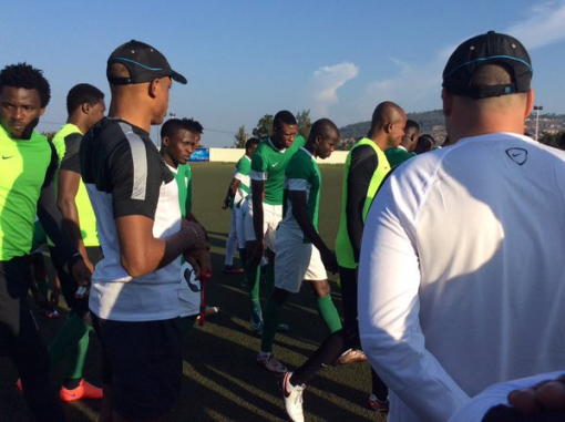 Home Eagles receiving pep talk from their coaches during a training session