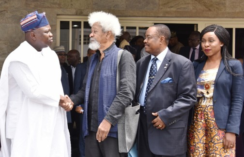 L-R: Lagos State Governor, Mr. Akinwunmi Ambode, in a warm handshake with Chairman, Committee for Lagos @ 50, Prof. Wole Soyinka, during the inauguration of Committee for Lagos @ 50, at the Banquet Hall, Lagos House, Ikeja, on Wednesday, February 10, 2016. With them are members of the Committee; Dr. Michael Olawole-Cole and Mrs. Bolanle Austin Peters.