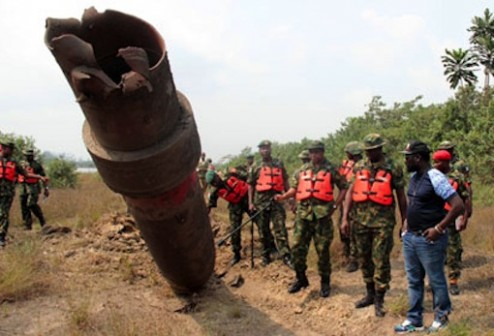 FILE PHOTO: A  pipeline destroyed by Niger Delta militants now known as 'Avengers'