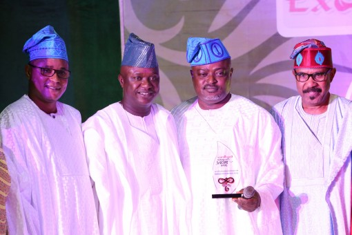 Speaker, Lagos State House of Assembly, Rt. Hon. Mudashiru Obasa (3rd right) holding the award plaque for the Most Outstanding House of Assembly and being flanked by his Deputy, Hon. Wasiu Sanni-Eshinlokun (left); Senator Babajide Omoworaree (2nd left) and Dr. Olorunmibe Mamora during the Award of Excellence organized by Global Excellence Magazine on Sunday in Lagos.