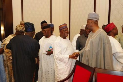 Senate president, Bukola Saraki and other APC chieftains take time out to greet each other