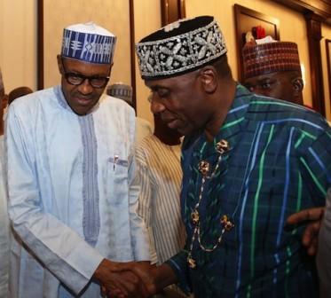 President Muhammadu Buhari shake hands with Minister of Transportation, Rotimi Amaechi