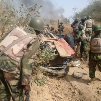 Nigerian troops assess the wreckage left behind