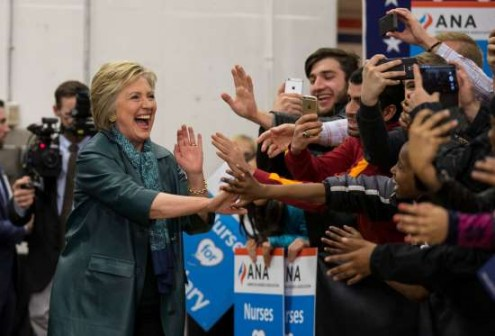 Democratic presidential candidate Hillary Clinton greets supporters during a rally at Rainier Beach High School on March 22, 2016 in Seattle, Washington. Clinton was spending the day in Washington ahead of the state's Democratic Party caucuses on March 26. © Stephen Brashear/Getty Images
