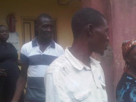 Nurudeen Sulamon (wearing white) escorted to prison by policemen behind him