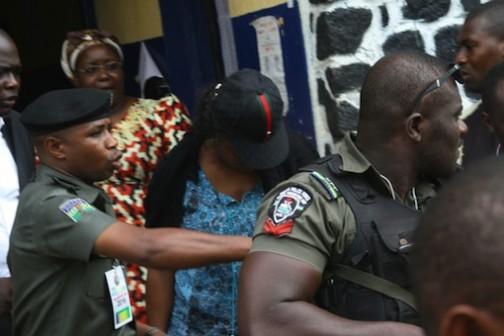 Mrs Ekwi Adebisa, INEC collation officer ushered away from Mile One police station