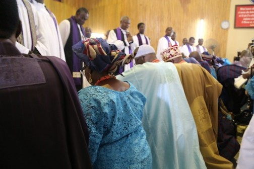 Prayer Time: Everyone kneels for prayer during the church service