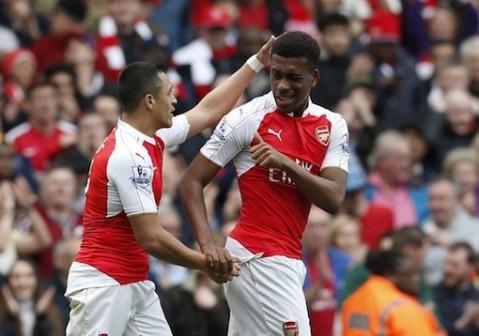 Alexis Sanchez and Alex Iwobi celebrate after scoring a goal