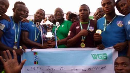 Chairman of Lagos State Football Association, Seyi   Akinwumi (middle) presents the Lagos FA Cup trophy to MFM FC players  at  the Agege Stadium on Sunday