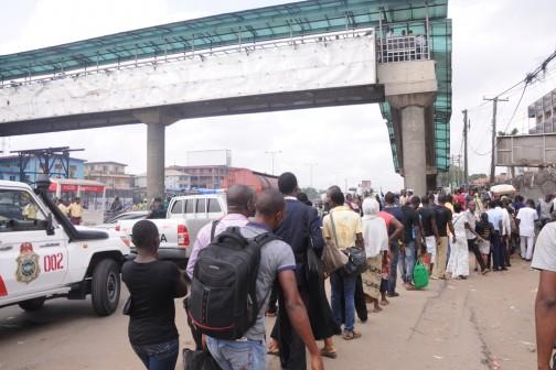 Commander, Rapid Response Squad, ACP Tunji Disu, leading his team to maintain peace and order on the usage of the Ojota Pedestrian Bridge, Lagos on Monday, April 11, 2016.